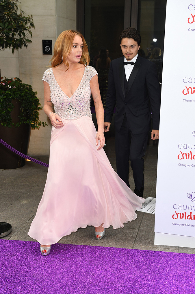 ** RESTRICTIONS: ONLY UNITED STATES, BRAZIL, CANADA ** London, UNITED KINGDOM - London, UK - Lindsay Lohan and fiancee, Egor Tarabasov, at The Caudwell Children Butterfly Ball held at the Grosvenor House Hotel. Lindsay had fluttery eyes for her man as they posed side-by-side on the event's purple carpet. Egor gave Lindsay her moment to shine solo as her and her ginger tresses posed elegantly in a flowing, blush colored gown. AKM-GSI 22 JUNE 2016 To License These Photos, Please Contact : Maria Buda (917) 242-1505 mbuda@akmgsi.com or Mark Satter (317) 691-9592 msatter@akmgsi.com sales@akmgsi.com