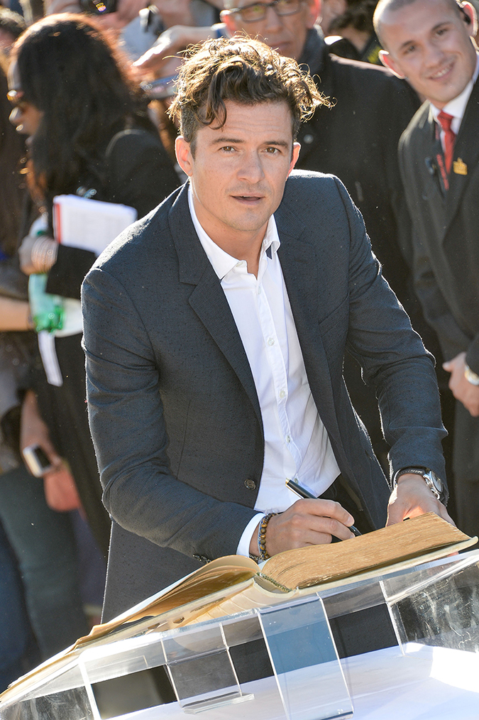 ** RESTRICTIONS: ONLY UNITED STATES ** Deauville, FRANCE - **USA ONLY** Deauville, France - Orlando Bloom poses outside the beach cabin named after him as part of a lifetime achievement tribute on the Promenade Des Planches during the 41st Deauville American Film Festival. 09/06/2015 Copyright © 2014 AKM-GSI, Inc. To License These Photos, Please Contact : Maria Buda (917) 242-1505 mbuda@akmgsi.com or Steve Ginsburg (310) 505-8447 (323) 423-9397 steve@akmgsi.com sales@akmgsi.com