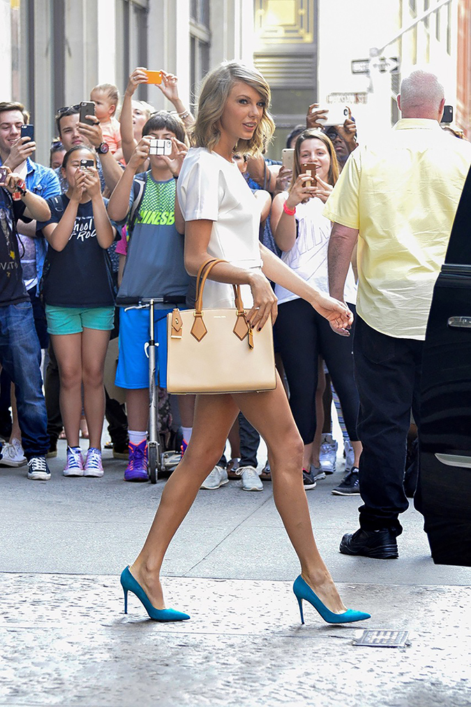 New York, NY - New York, NY - Taylor Swift caused quite the crowd on Wednesday afternoon as she stepped out of her Soho apartment to a mob of fans. The pop princess looked adorable in a white mini dress, turquoise pumps, and a Michael Kors tote bag. AKM-GSI May 27, 2015 To License These Photos, Please Contact : Steve Ginsburg (310) 505-8447 (323) 423-9397 steve@akmgsi.com sales@akmgsi.com or Maria Buda (917) 242-1505 mbuda@akmgsi.com ginsburgspalyinc@gmail.com 05/27/2015 Copyright © 2014 AKM-GSI, Inc. To License These Photos, Please Contact : Maria Buda (917) 242-1505 mbuda@akmgsi.com or Steve Ginsburg (310) 505-8447 (323) 423-9397 steve@akmgsi.com sales@akmgsi.com