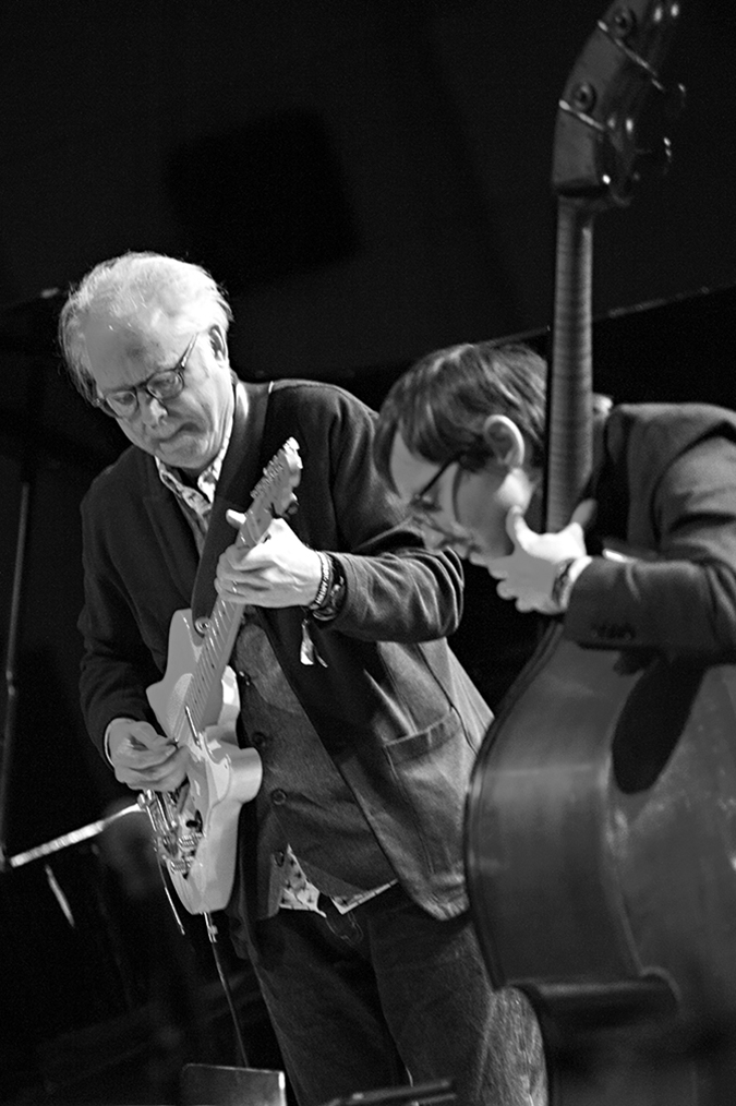 20170107©DayJazzFest2571.jpg The 13th Anual Winter JazzFest played over a snowy weekend from January 5th- January 10. Bill Frisell, Thomas Morgan Duo performing Saturday night at the New School Tishman Auditorium.