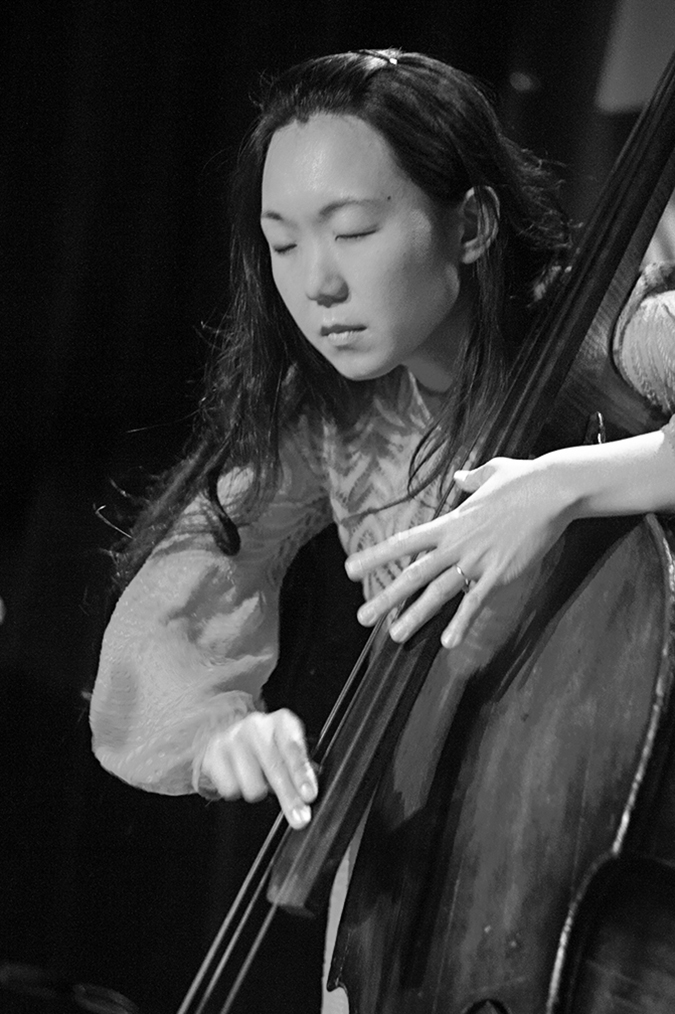 20170108©DayJazzFest2845.jpg The 13th Anual Winter JazzFest played over a snowy weekend from January 5th- January 10. Linda Oh performing at the Thelonius Monk 100th Birthday Improv Show, Sunday, January 8th at Littlefield in Brooklyn
