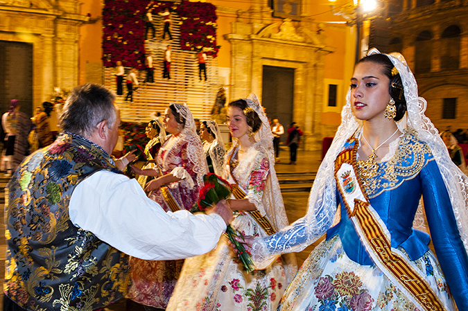 20170319©DAYFallasFestival2958.jpg Thousands of performers and spectators celebrate the Falles Festival on St. Joseph's Day in Valencia Spian on the last day of Fallas. L'Ofrena de flors, Casals fallers handing the flower offering to the virgin.