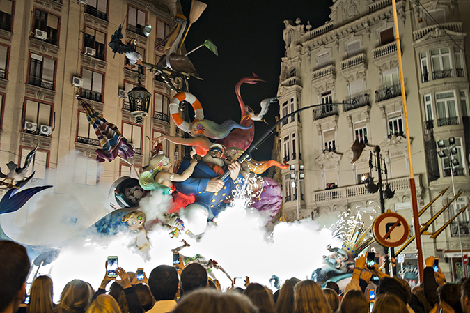 20170319©DAYFallasFestival5232.jpg Thousands of performers and spectators celebrate on St. Joseph's Day in Valencia Spain on the last day of Fallas. Falla Grabador Esteve-Cirilo Amoros starts to burn at the stroke of midnight.