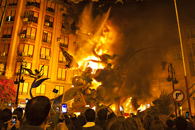 20170319©DAYFallasFestival5256.jpg Thousands of performers and spectators celebrate on St. Joseph's Day in Valencia Spain on the last day of Fallas. Falla Grabador Esteve-Cirilo Amoros starts to burn at the stroke of midnight.
