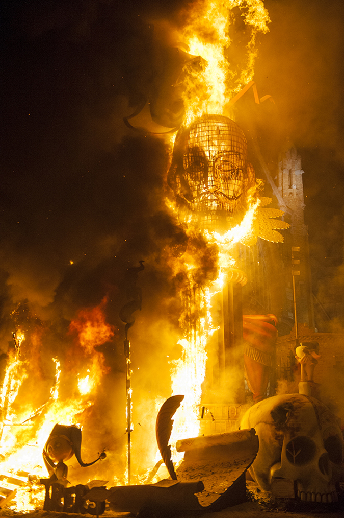 20170319©DAYFallasFestival5668.jpg Thousands of performers and spectators celebrate on St. Joseph's Day in Valencia Spain on the last day of Fallas. Falla starts to burn at the stroke of midnight.