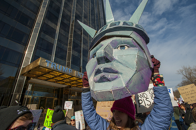 20180120©DayWomansMarch0844.jpg Woman's March in Manhattan, NY. Under cloudy parting skies, tens of thousands women, men, and children marched down Central Park West and Sixth Ave. for 6hours. All protesting Donald Trump policies on the one year anniversary of the 2017 Woman's March and Ttump's first year in office.