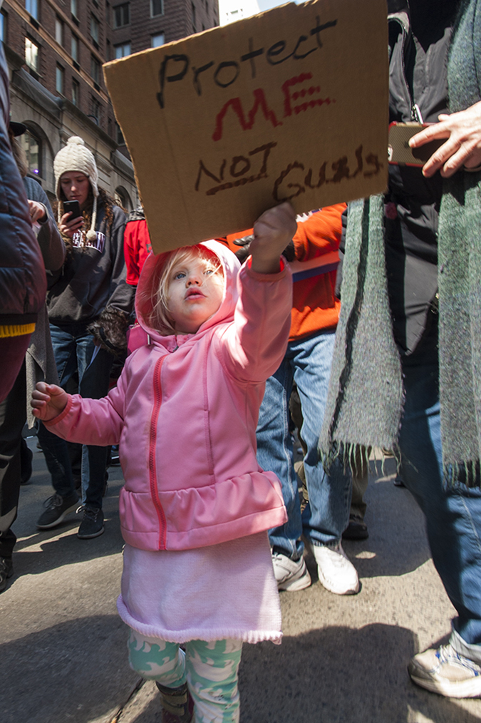 20181324©DayMarchforLives2336.jpg March For Our Lives in Manhattan, NY. Under sunny cool skies, one hundred thousand women, men, and children marched down Central Park West and Sixth Ave. for 6 hours. All protesting Donald Trump policies on Gun Control and remembering those who have been lost to gun violence.