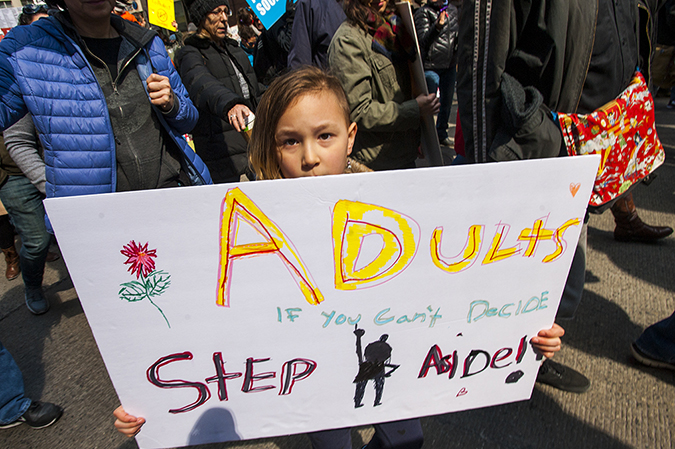 20181324©DayMarchforLives2437.jpg March For Our Lives in Manhattan, NY. Under sunny cool skies, one hundred thousand women, men, and children marched down Central Park West and Sixth Ave. for 6 hours. All protesting Donald Trump policies on Gun Control and remembering those who have been lost to gun violence.