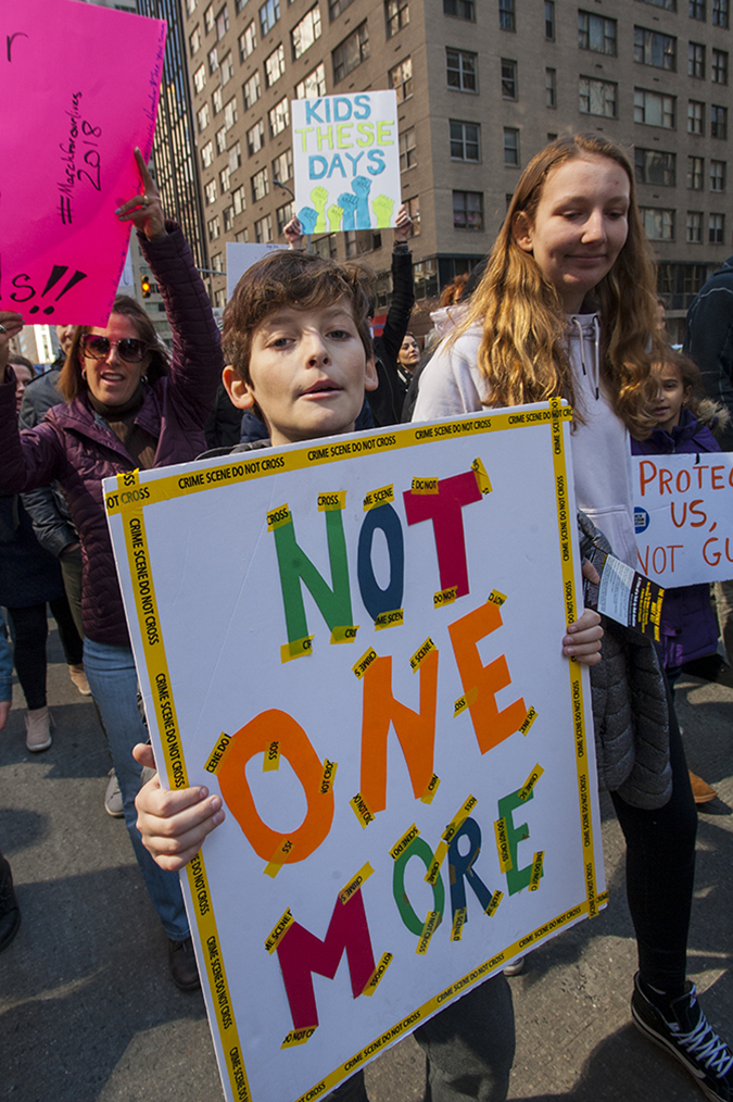20181324©DayMarchforLives2693.jpg March For Our Lives in Manhattan, NY. Under sunny cool skies, one hundred thousand women, men, and children marched down Central Park West and Sixth Ave. for 6 hours. All protesting Donald Trump policies on Gun Control and remembering those who have been lost to gun violence.