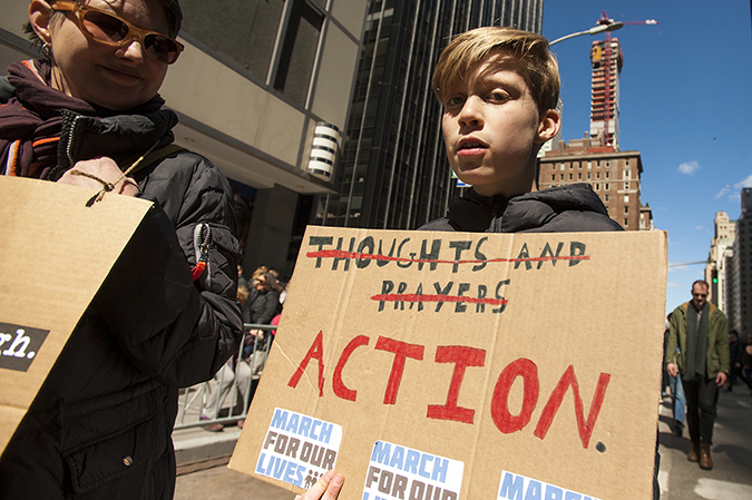 20181324©DayMarchforLives2892.jpg March For Our Lives in Manhattan, NY. Under sunny cool skies, one hundred thousand women, men, and children marched down Central Park West and Sixth Ave. for 6 hours. All protesting Donald Trump policies on Gun Control and remembering those who have been lost to gun violence.