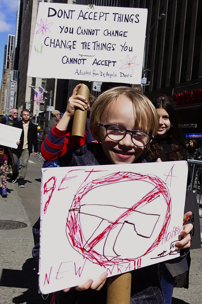 20181324©DayMarchforLives9520.jpg March For Our Lives in Manhattan, NY. Under sunny cool skies, one hundred thousand women, men, and children marched down Central Park West and Sixth Ave. for 6 hours. All protesting Donald Trump policies on Gun Control and remembering those who have been lost to gun violence.