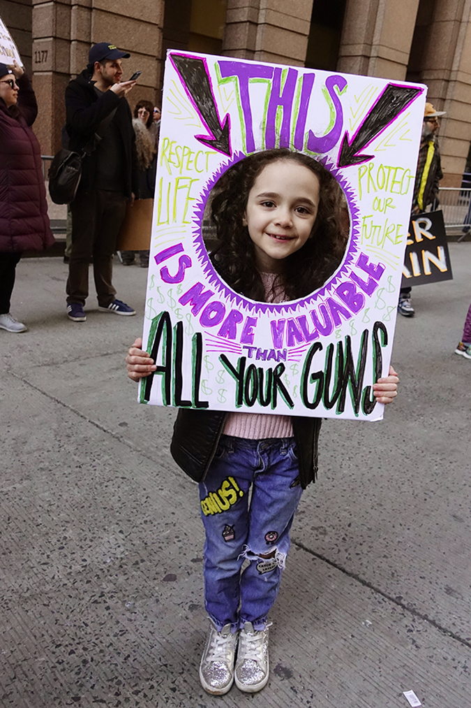 20181324©DayMarchforLives9694.jpg Under sunny cool skies; one hundred thousand; women; men; and children marched down Central Park West and Sixth Ave. for 6 hours.; All protesting Donald Trump policies on Gun Control and remembering those who have been lost to gun violence.