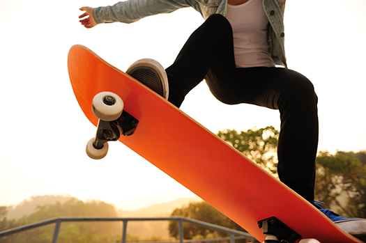 skateboarding woman sunrise lzf shutterstock