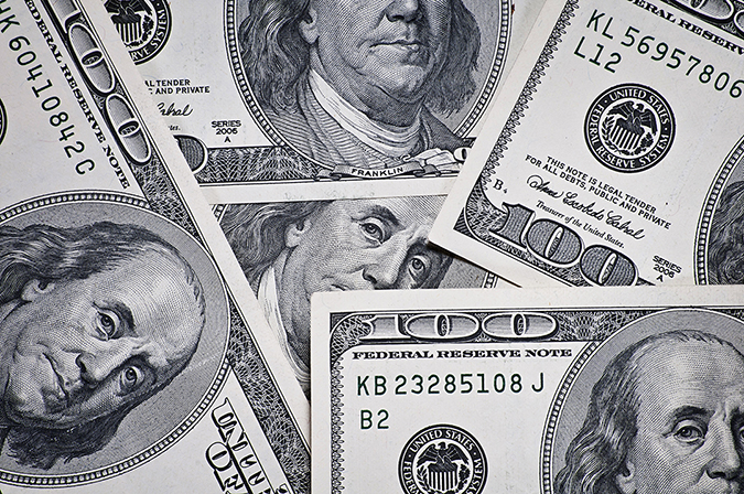 100 dollar bills - Wojciech_Zalewski - Shutterstock