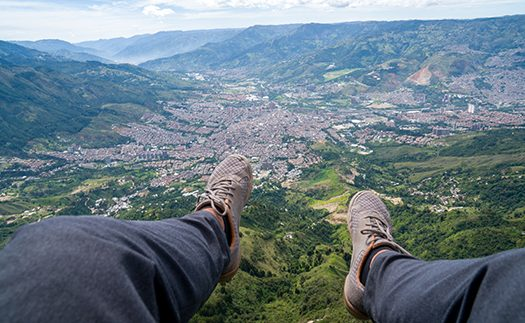 paragliding over medellin - The NewsWhistle 1119 - Paragliding Over Medellin - Shutterstock