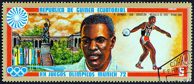 rafer johnson - equatorial guinea stamp - Lefteris Papaulakis - Shutterstock - Embed
