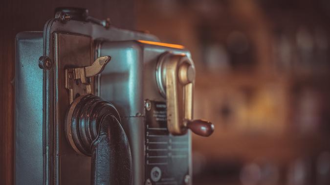 old public telephone - Aris Suwanmalee - Shutterstock - embed