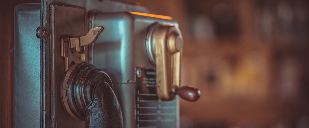 old public telephone - Aris Suwanmalee - Shutterstock