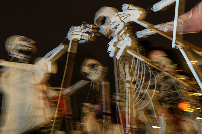 20191031©DAYHalloween7714.jpg The 46th Halloween Parade rolls up 6th Avenue as the giant skelton puppet leading the way under clear skies and 55º temperture..