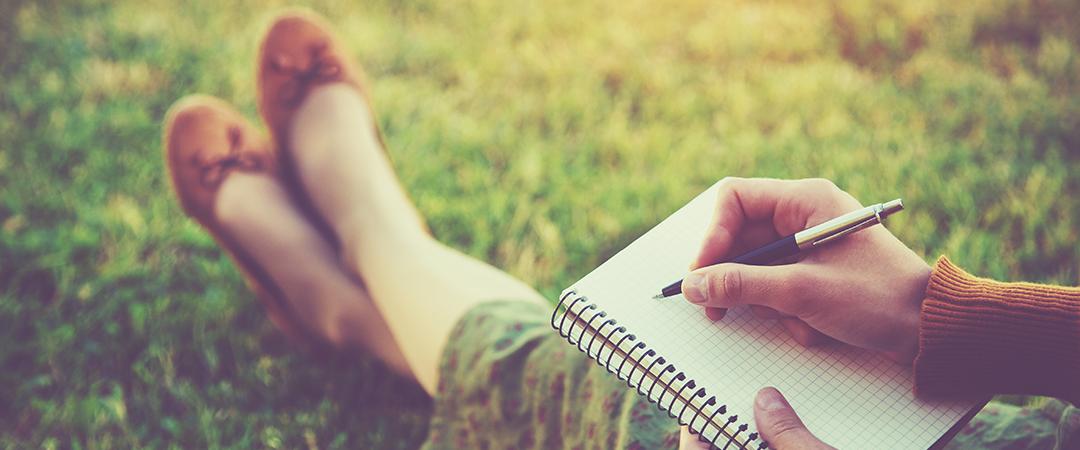 writing in notebook - stock image - Ivan Kruk - Shutterstock