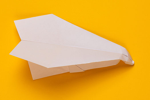crumpled paper airplane - Stas Knop - Shutterstock