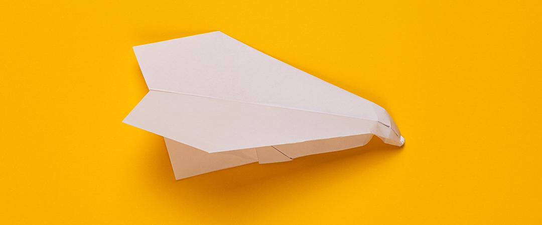 crumpled paper airplane - Stas Knop - Shutterstock