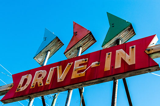 drive in movie sign - Brian McHugh - Shutterstock