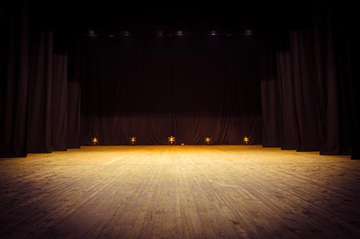 an empty stage - photo by Kozlik - Shutterstock